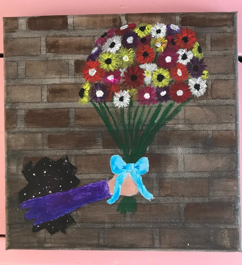 Hand holding a bouquet of gerbera-like flowers. The flowers are in the colours yellow, white, pink, purple, red and orange with white and black centers. Around the flower steels is a light blue ribbon. The arm wears a purple sleeve and comes through a hole in a brown brick-stone wall. Through the hole there is space with stars.
